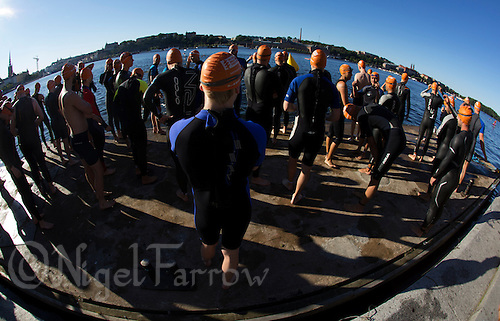 25 AUG 2013 - STOCKHOLM, SWE - Competitors wait for their wave start of the Stockholm Triathlon in front of Stockholm City Hall, Stockholm, Sweden (PHOTO COPYRIGHT © 2013 NIGEL FARROW, ALL RIGHTS RESERVED)