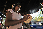 As the sun rises, Petronila Escalante prepares a tortilla for cooking in El Bonete, Nicaragua. Usually made of corn, the tortilla is a staple in diets throughout Central America and Mexico.