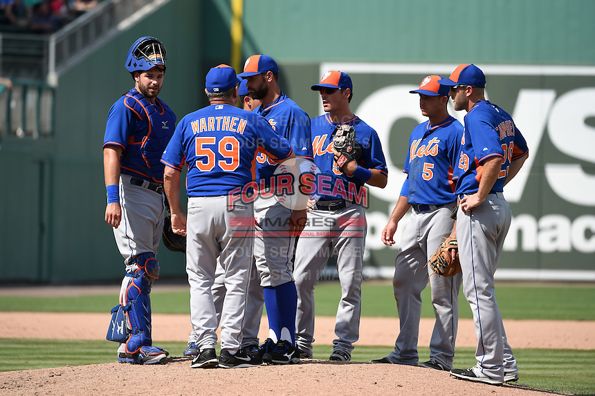 New York Mets pitching coach Dan Warthen (59) talks with pitcher pitcher Sean Gilmartin (36) as catcher Kevin Plawecki (22), Danny Muno (behind Gilmartin), Matt Reynolds (55), T.J. Rivera (5) and Eric Campbell (29) look on during a Spring Training game against the Boston Red Sox on March 16, 2015 at JetBlue Park at Fenway South in Fort Myers, Florida.  Boston defeated New York 4-3.  (Mike Janes/Four Seam Images)