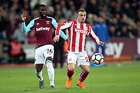 Xherdan Shaqiri of Stoke City and Arthur Masuaku of West Ham United during West Ham United vs Stoke City, Premier League Football at The London Stadium on 16th April 2018