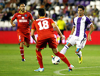 Real Valladolid´s Javi Guerra (l) and Getafe's  Rafa Lopez (r) during La Liga match.August 31,2013. (ALTERPHOTOS/Victor Blanco)