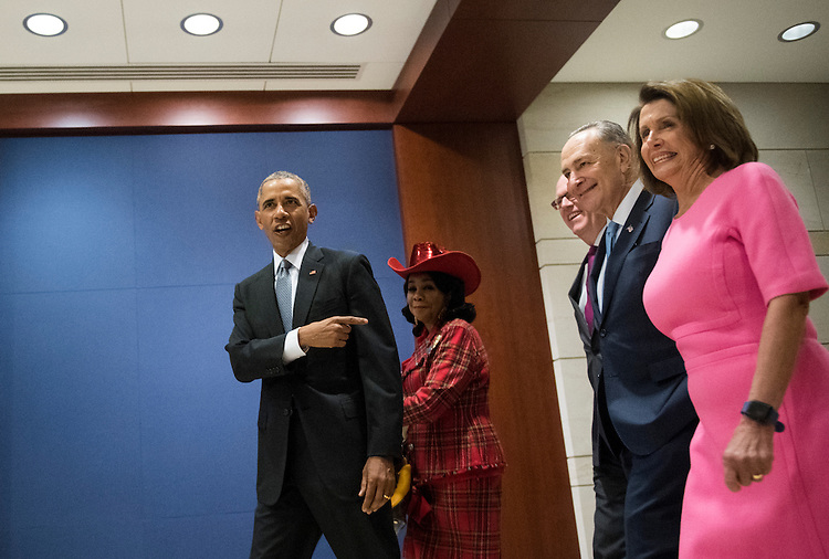 UNITED STATES - JANUARY 4: From left, President Barack Obama, Rep. Frederica Wilson, D-Fla., Rep. Joe Crowley, D-N.Y., Senate Minority Leader Chuck Schumer, D-N.Y.,  and House Minority Leader Nancy Pelosi, D-Calif., arrive in the Capitol Visitor Center for the meeting of House and Senate Democrats to discuss health care reform on Wednesday, Jan. 4, 2017. (Photo By Bill Clark/CQ Roll Call)