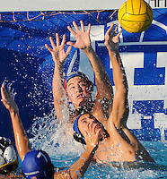 Boys High School water polo. Goalie tries to make a stop with a little help from his friends.