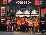 Runners participate at the Bloomberg Square Mile Relay near the Huangpu River in Shanghai, China. Photo by Marcio Machado / Power Sport ImagesRunners participate at the Bloomberg Square Mile Relay near the<br /> Huangpu River in Shanghai, China. Photo by Marcio Machado /<br /> Power Sport ImageS