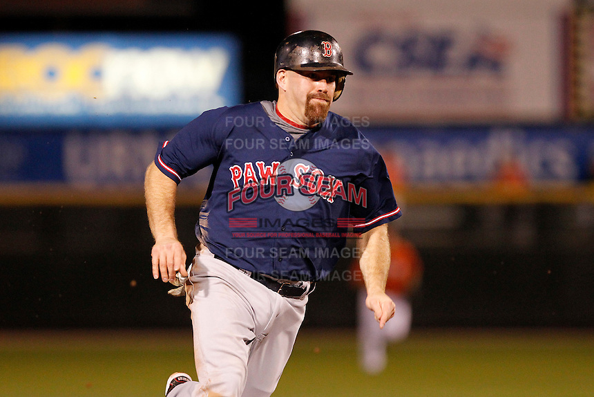Boston Red Sox outfielder designated hitter Kevin Youkilis #46 rounds third base while playing in a rehab assignment game with the Pawtucket Red Sox against the Rochester Red Wings  at Frontier Field on August 30, 2011 in Rochester, New York.  Rochester defeated Pawtucket 8-6.  (Mike Janes/Four Seam Images)