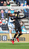 17th March 2018, The John Smiths Stadium, Huddersfield, England; EPL Premier League football, Huddersfield Town versus Crystal Palace; Christian Benteke of Crystal Palace chests the ball under heavy pressure from Christopher Schindler of Huddersfield Town