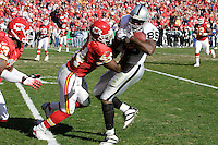 Chiefs safety Jarrad Page tackles Oakland Raiders tight end Randal Williams on a 21 yard pass play in the second quarter at Arrowhead Stadium in Kansas City, Missouri on November 19, 2006. The Chiefs won 17-13.