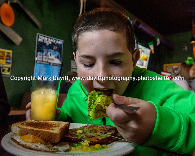 Founder's Irish Pub held its annual St. Patricks Day Kegs and Eggs featuring green eggs and ham and green beer in Bondurant March 17. Breakfast is delivered to a hungry Chase Burke, 96 of Pleasant Hill. He was there with his dad Brian and sister, Kasey, 6.