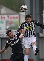 Jason Naismith beats Graham Carey in the air in the St Mirren v Ross County Scottish Professional Football League Premiership match played at St Mirren Park, Paisley on 3.5.14.