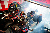 Feb 7, 2020; Pomona, CA, USA; Crew members surround the car of NHRA funny car driver Alexis DeJoria as she warms up in the pits prior to qualifying for the Winternationals at Auto Club Raceway at Pomona. Mandatory Credit: Mark J. Rebilas-USA TODAY Sports