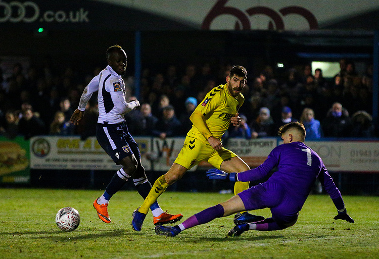 Fleetwood Town's Ched Evans sees his shot saved by Guiseley's Joe Green in the closing stages<br /> <br /> Photographer Alex Dodd/CameraSport<br /> <br /> The Emirates FA Cup Second Round - Guiseley v Fleetwood Town - Monday 3rd December 2018 - Nethermoor Park - Guiseley<br />  <br /> World Copyright &copy; 2018 CameraSport. All rights reserved. 43 Linden Ave. Countesthorpe. Leicester. England. LE8 5PG - Tel: +44 (0) 116 277 4147 - admin@camerasport.com - www.camerasport.com