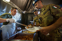 An Italian soldier from the  Fifth  Lancieri of Novara regiment of the Italian Cavalry is served lunch by a military cook in the UNIFIL Chama base in Southern Lebanon on Friday Dec 08 2006..Close to 1000 Italian peacekeepers operate in  the in Southern lebanon town of Chama, constantly patrolling their sector in search for illegal weapons in the country.