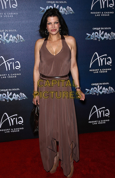 Carla Pellegrino.Red Carpet Premiere of Zarkana by Cirque Du Soleil at Aria Resort and Casino, Las Vegas, Nevada, USA, .9th November 2012..full length brown long maxi sleeveless dress  .CAP/ADM/MJT.© MJT/AdMedia/Capital Pictures.
