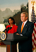 United States President George W. Bush announces he will widen economic sanctions on Myanmar's military rulers, piling on pressure for a transition to democracy after a bloody crackdown on anti-junta protests, in the Diplomatic Room of the White House in Washington, DC on October 19, 2007. The move comes only days after the European Union increased its sanctions against the regime. Standing with the President is US Secretary of State Condoleezza Rice, left.<br /> Credit: Aude Guerrucci / Pool via CNP