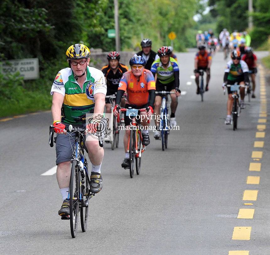Taoiseach Enda Kenny freewheels into Kenmare after travelling over 100 miles on the annual Ring of Kerry Charity cycle. The Taoiseach shows his energy by taking only one stop on the trip when most cyclists would take at least three..Picture by Don MacMonagle