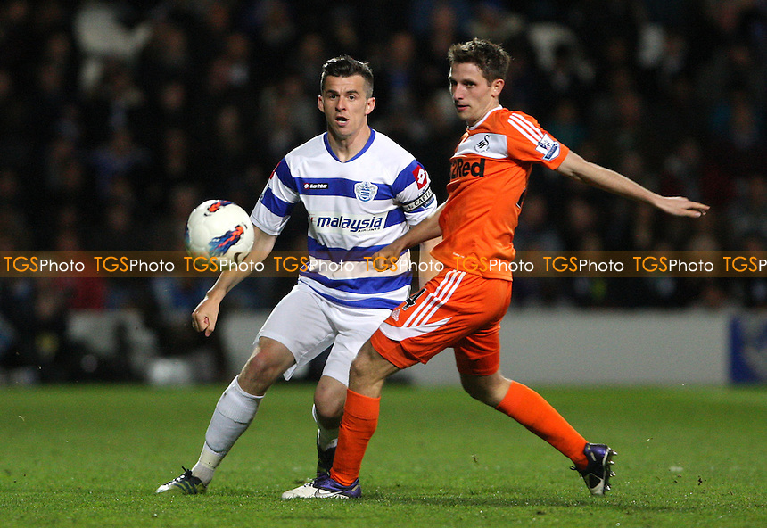 Joey Barton of QPR and Joe Allen of Swansea - Queens Park Rangers vs Swansea City, Barclays Premier League at Loftus Road, London - 11/04/12 - MANDATORY CREDIT: Rob Newell/TGSPHOTO - Self billing applies where appropriate - 0845 094 6026 - contact@tgsphoto.co.uk - NO UNPAID USE..