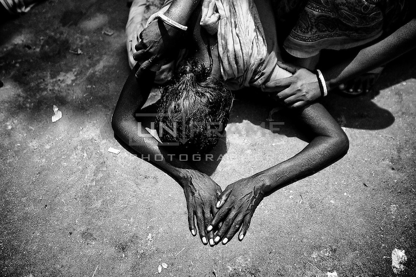 After 15 days of the Shavar Building collapse, Bobita's family found her dead body. After the identification, Bobita's mother lost her sense in the Adhar Chandra High School field.