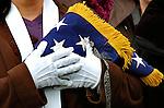 Arlington National Cemetery. Holding flag to heart.