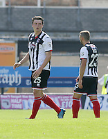 Matt Robinson of Grimsby Town looks dejected after he heads in to his own net