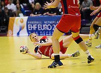 22 MAR 2012 - LOUGHBOROUGH, GBR - Great Britain captain Lynn McCafferty (GBR) passes from the floor during the women's 2012 European Handball Championships qualification match against Poland at Loughborough University in Loughborough, Great Britain (PHOTO (C) 2012 NIGEL FARROW)