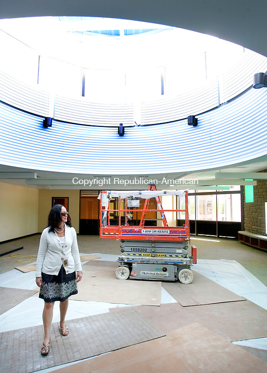 PROSPECT CT. 14 May 2015-051215SV04-Rima McGeehan, principal, walks through the media center with a large skylight at the new Prospect Elementary School on New Haven Road in Prospect Thursday. <br /> Steven Valenti Republican-American