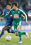 Getafe's Damian Suarez (l) and Sociedad Deportiva Eibar's Takashi Inui during La Liga match. March 18,2016. (ALTERPHOTOS/Acero)