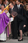 Queen Sofia of Spain (R) kisses Archbishop of Madrid Rouco Varela (L) in his hand after leaving the state funeral for former Spanish prime minister Adolfo Suarez at the Almudena Cathedral in Madrid, Spain. March 31, 2014. (ALTERPHOTOS/Victor Blanco)