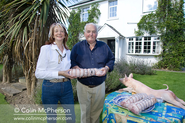 Meat traders Barry and Gillian Pugh with an example of their produce at their home at Garstang, Lancashire, northwest England. The couple founded Pugh's Piglets in the 1970s, a business which supplied pork meat to restaurants across the UK. They bought in stock from farms and then sell the meat on to clients.