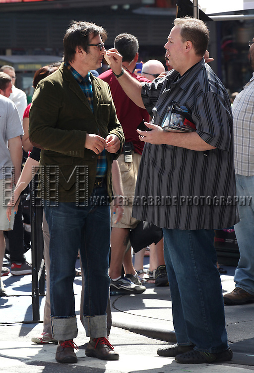 Jon Robin Baitz filming a scene from the NBC TV Show 'Smash' in Times Square, New York City on September 12, 2012