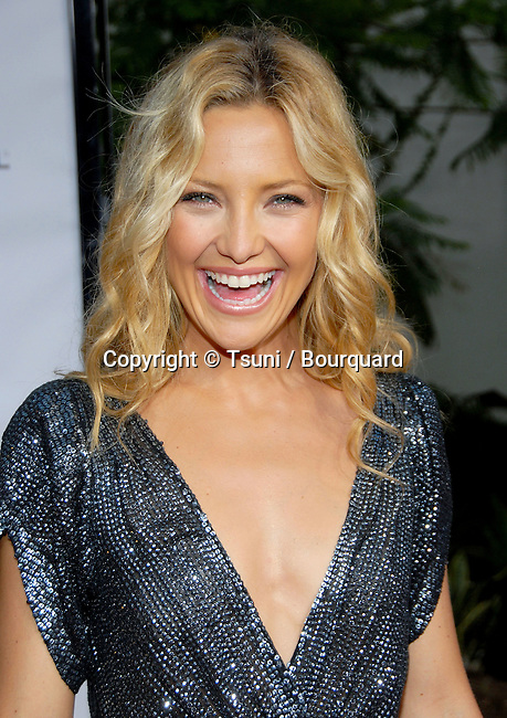 Kate Hudson arriving at the YOU, ME AND DUPREE Premiere at the Arclight Theatre  In Los Angeles. July 10,  2006.<br /> head shot
