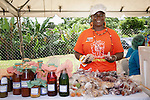 Smiling woman vendor selling homemade local produce, Mason Hall Tobago Heritage Festival