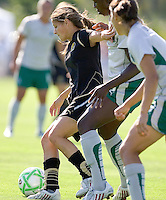 Tina DiMartino (left) controls the ball against two St. Louis defenders. St. Louis Athletica defeated FC Gold Pride 1-0 at Buck Shaw Stadium in Santa Clara, California on July 5, 2009.