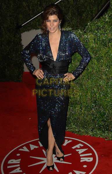 MARISA TOMEI.The 2010 Vanity Fair Oscar Party held at The Sunset Tower Hotel in West Hollywood, California, USA..March 7th, 2010.oscars full length dress wrap hands on hips waistband black low cut neckline dangling earrings blue sequins sequined .CAP/RKE/DVS.©DVS/RockinExposures/Capital Pictures.