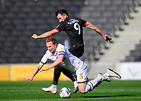 Lincoln City's Tom Hopper battles with Milton Keynes Dons' Dean Lewington<br /> <br /> Photographer Chris Vaughan/CameraSport<br /> <br /> The EFL Sky Bet League One - Milton Keynes Dons v Lincoln City - Saturday 19th September 2020 - Stadium MK - Milton Keynes<br /> <br /> World Copyright © 2020 CameraSport. All rights reserved. 43 Linden Ave. Countesthorpe. Leicester. England. LE8 5PG - Tel: +44 (0) 116 277 4147 - admin@camerasport.com - www.camerasport.com