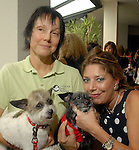 Janie Lee with Poppy and Amy Walther with Bobettte Marley at the Hotel Derek fund-raising dog luncheon to benefit CAP Saturday May 02,2009.(Dave Rossman/For the Chronicle)