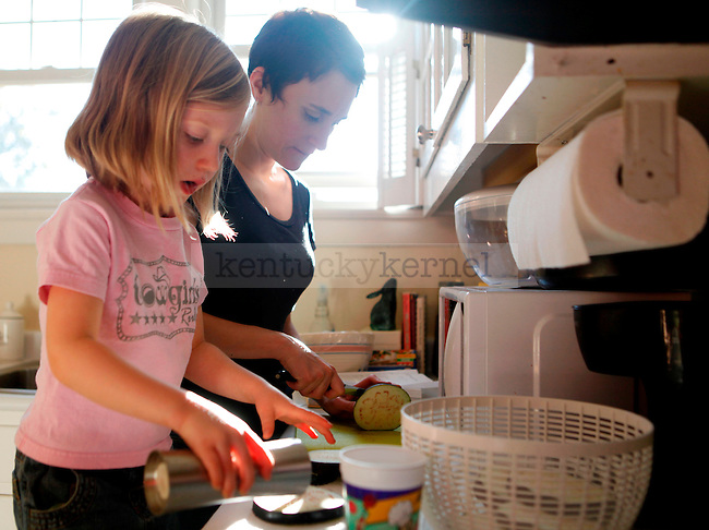 """Meg Marquis, aka """"Rainbow Smite,"""" and her daughter Sophia Shannon, AGE, prepare the ingredients to make eggplant calizones in the kitchen of their home on Oct. 26, 2009..Photo by Zach Brake 