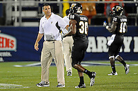 1 September 2011:  FIU Head Football Coach Mario Cristobal speaks with tight end Jonathan Faucher (30) after a big play in the second half as the FIU Golden Panthers defeated the University of North Texas, 41-16, at FIU Stadium in Miami, Florida.