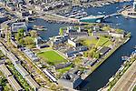 Nederland, Noord-Holland, Amsterdam, 09-04-2014;<br /> Nederland, Noord-Holland, Amsterdam, 09-04-2014;<br /> Marineterrein en Kattenburg, Scheepvaartmuseum, de IJtunnel en museum Nemo met historische woonboten. <br /> Rechts de Dijksgracht en het spoor.<br /> Navy area and the National Maritime Museum (white building), right Museum Nemo.<br /> luchtfoto (toeslag op standard tarieven);<br /> aerial photo (additional fee required);<br /> copyright foto/photo Siebe Swart