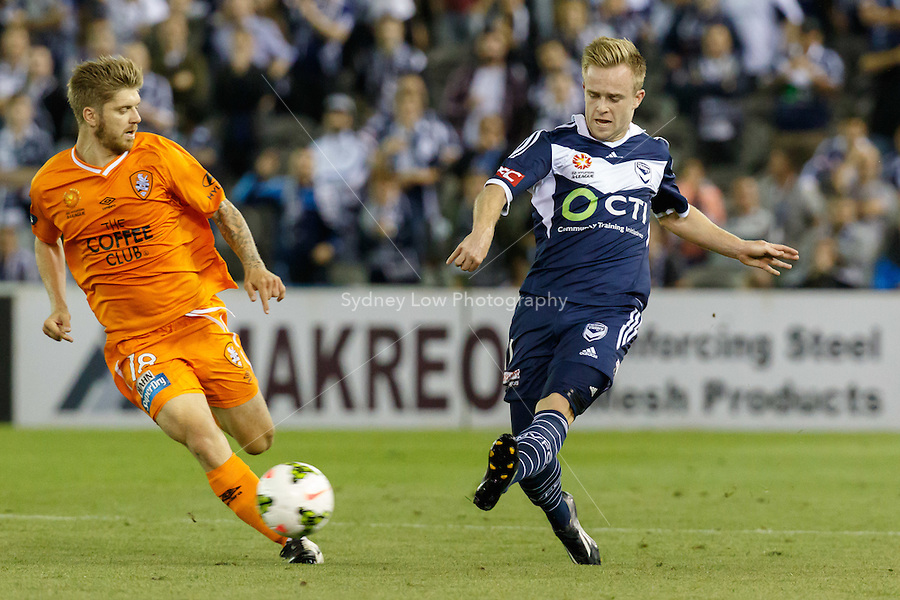 Connor PAIN of the Victory passes the ball in the round seven match between Melbourne Victory and Brisbane Roar in the Australian Hyundai A-League 2014-15 season at Etihad Stadium, Melbourne, Australia.