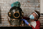 Pictured: Museum director Kevin Casey wears PPE as he dusts an early 20th century Heinke Pearler diving helmet on display at the Diving Museum in Gosport, Hants.<br /> <br /> With museums set to open this forthcoming Saturday on July 4th inline with the Governments easing of lockdown restrictions, the Diving Museum is keeping its doors closed unti April 2021. <br /> <br /> The museum cannot safely introduce social distancing measures, and as a volunteer run institution most members of staff are considered vulnerable.<br /> <br /> © Jordan Pettitt/Solent News & Photo Agency<br /> UK +44 (0) 2380 458800