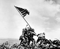 Flag raising on Iwo Jima.  February 23, 1945.  Joe Rosenthal, Associated Press.  (Navy)<br /> NARA FILE #:  080-G-413988<br /> WAR &amp; CONFLICT BOOK #:  1221