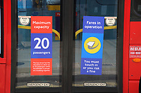 Warnings on London buses<br /> Social Distancing, Hand Sanitiser stations and NHS signage around London as Lockdown restrictions are loosened by allowing Pubs, Restaurants and all retail to re-open. London on Saturday July 4th 2020<br /> <br /> Photo by Keith Mayhew