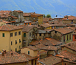 The  hilltop town of Barga is located in the northwest  part of Tuscany-called Garfagnana. The timeless beauty of the red tile roofs can be admired from miles away. The different heights and shapes of the roofs   creates  an interesting architectural sight.