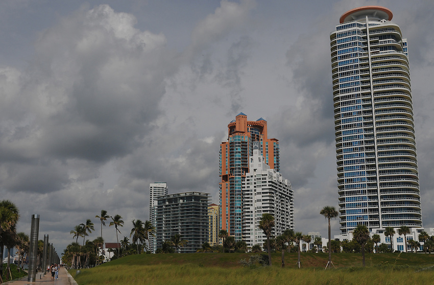 From the tip of South Beach, South Point, looking west, people jog the boardwalk, enjoying the majesty of beautiful Miami Beach Florida