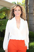 ***FILE PHOTO*** Felicity Huffman and Lori Loughlin Indicted in College Admission Bribery Case.<br /> BEVERLY HILLS, CA - APRIL 16:  Felicity Huffman at Eva Longoria's Star On The Hollywood Walk Of Fame Ceremony Post Luncheon in Beverly Hills, California on April 16, 2018. <br /> CAP/MPIFS<br /> &copy;MPIFS/Capital Pictures
