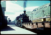 This may be D&amp;RGW #453 switching fishbelly flat car #6520 in front of the Durango depot with coaling tower in background.<br /> D&amp;RGW  Durango, CO