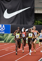 EUGENE, OR--Maria Mutola, 1, battles with Kenia Sinclair, 5, during the 800 meters at the Steve Prefontaine Classic, Hayward Field, Eugene, OR. SUNDAY, JUNE 10, 2007. PHOTO © 2007 DON FERIA
