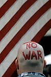 Protester at the Federal Building in downtown Seattle with painted head stating No War protesting the US involvement in Persian Gulf January 15 deadline 1991 Seattle Washington State USA