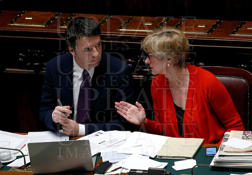 Il Presidente del Consiglio Matteo Renzi ascolta il Ministro della Difesa Roberta Pinotti alla Camera dei Deputati in occasione del voto di fiducia sul suo governo, Roma, 24 febbraio 2014.<br /> Italian Premier Matteo Renzi listens to Defense Minister Roberta Pinotti, right, during a plenary session on the occasion of the confidence vote on his newly born government at the Lower Chamber, Rome, 24 February 2014.<br /> UPDATE IMAGES PRESS/Isabella Bonotto