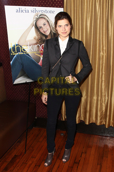 """LAKE BELL .""""The Kind Diet"""" launch party held at The Candle 79,  New York, NY, USA, .8th September 2009..full length suit trousers hand on hip black white shirt open toe brown shoes ankle boots booties shooboots .CAP/ADM/PZ.©Paul Zimmerman/AdMedia/Capital Pictures."""